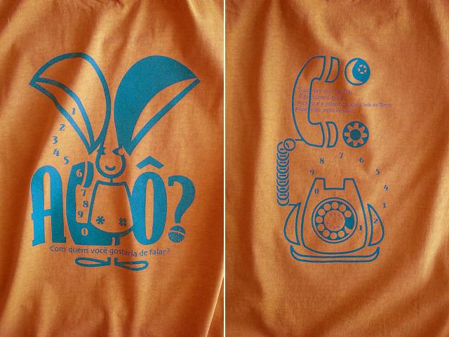 オレリャォンと黒電話Tシャツ-hinolismo-迷えるマリーゴールド
