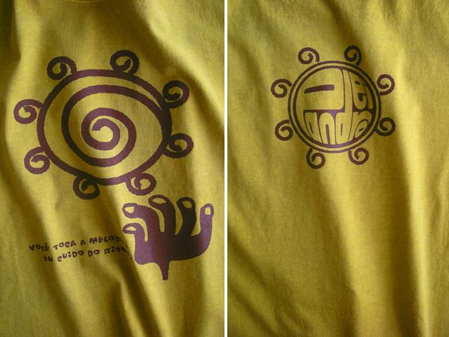hinolismo迷えるTシャツ-マスタード-Pandeiro(パンデイロ)-きみはメロディを、わたしがリズムを